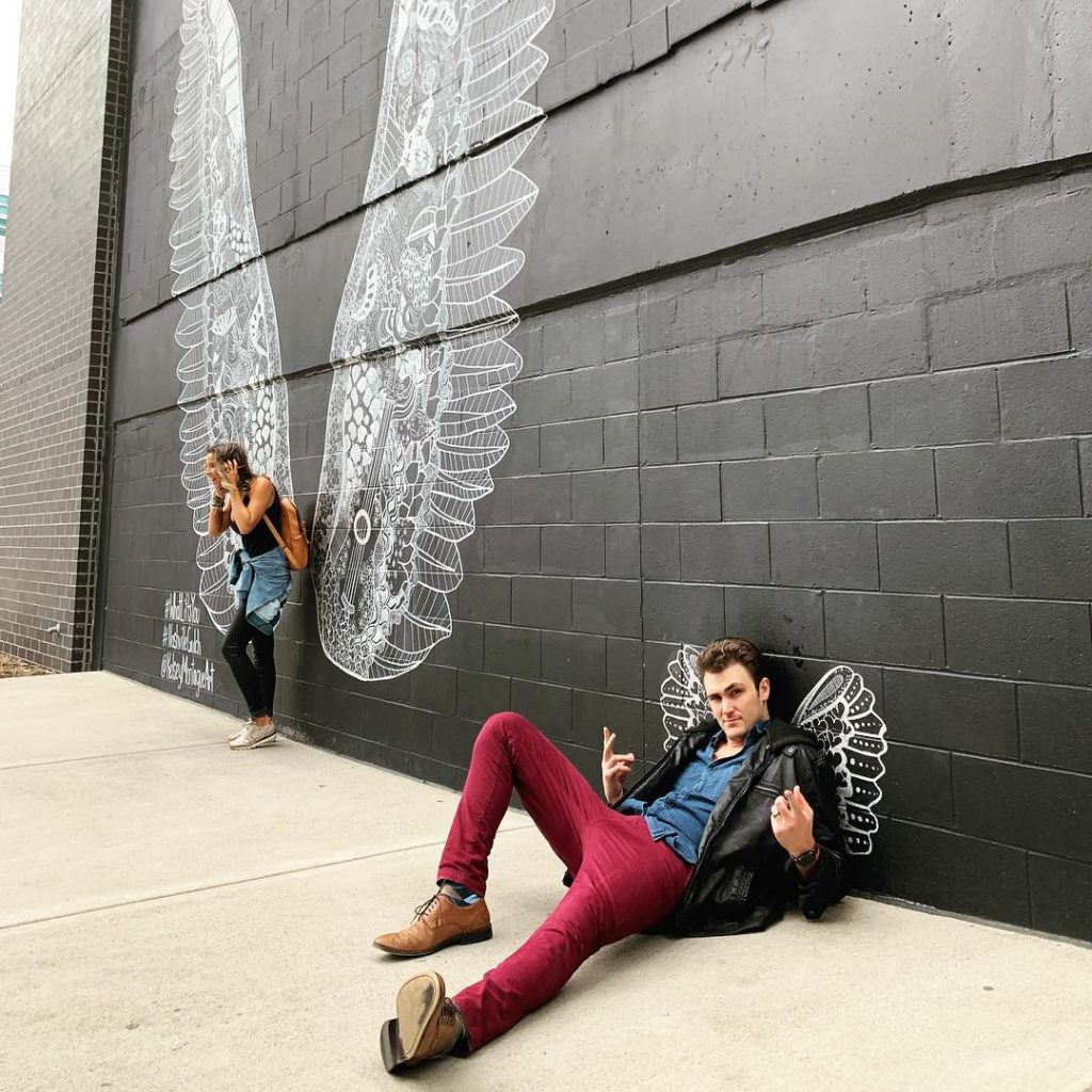 Couple posing by nashville mural