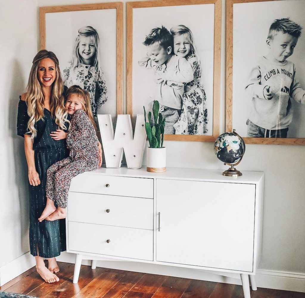 kids in front of framed photos