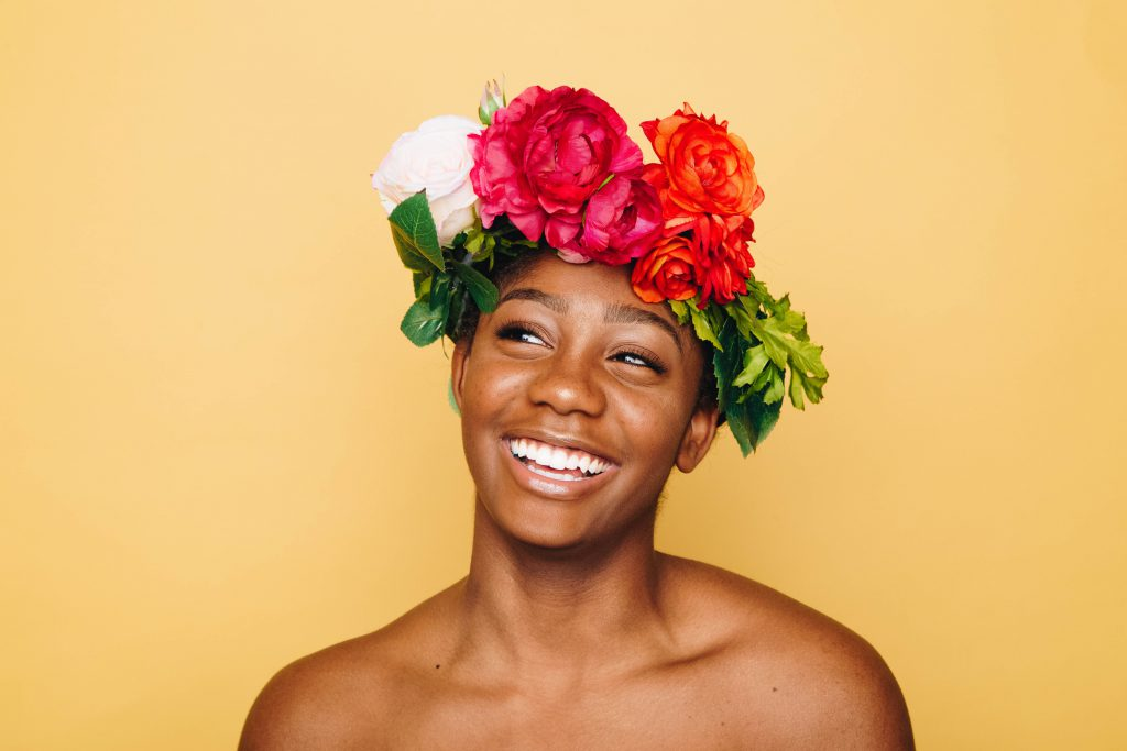 Girl smiling with a flower