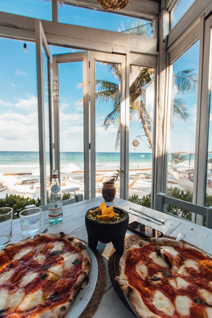 Eating pizza in hotel room on vacation