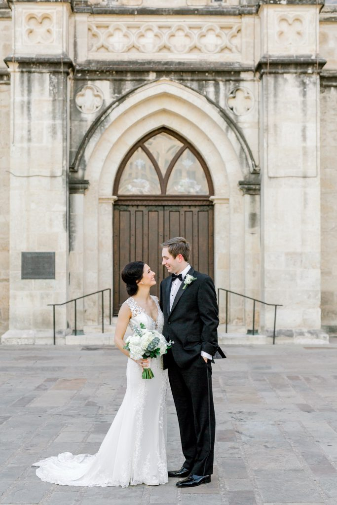 bride and groom by church