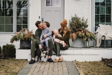 Family Posing on their front porch